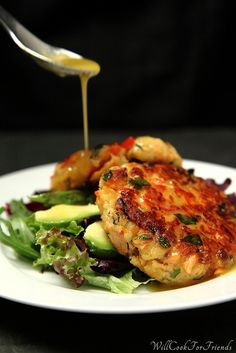 Salmon Cakes with Honey Mustard Vinaigrette  Makes 6-7 small patties (2 patties per serving)    Ingredients:    1 lb. salmon, skin removed  1 cup water  1/2 lemon, juice and zest  1 1/3rd cup panko breadcrumbs*  1 1/2 TBSP all purpose flour  1/2 red bell pepper, diced small  1 small shallot, chopped fine  1/2 cup loosely pack