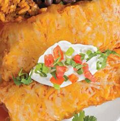 Showcase Hatch chiles in these yummy Hatch Chile Pepper Chicken Enchiladas. Chopped peppers are sautéed with onions and mixed into the filling and then shredded Hatch chile cheese (or shredded pepper jack) is melted on top. A double dose of flavor never tasted so good.