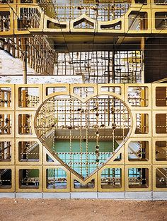A Machine for Dreaming In: Robert Stone's Psychadelic Acido Dorado | The heart cast into the screen's concrete blocks measures 4 feet across. #design #interiordesign #interiordesignmagazine #architecture #gold