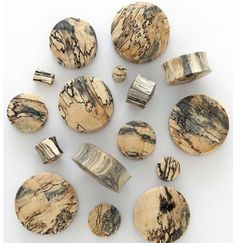 Tamarind wood carved saddle plugs 2g 6mm I really love the wood grain on these it looks like tree bark mixed with cheetah