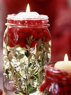 Fill the bottom of a jar with the greenery of your choice and a handful or two of cranberries. When you add water the cranberries will float to the top, then add a floating candle for a beautiful centerpiece.