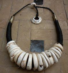 Necklace |  Faouzi Designs. Conus shell, fiber and metal