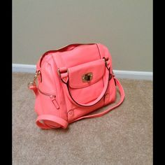 Fluorescent Pink cross-body purse BNWOT Brand new! Beautiful purse. Cross body strap is detachable. Super roomy inside and tons of pockets! Merona Bags Crossbody Bags