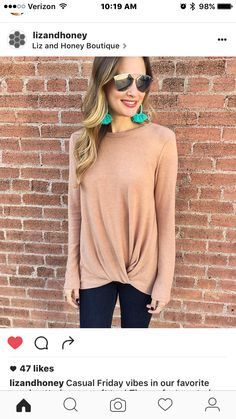 Love the simple sweater with a knot at the bottom