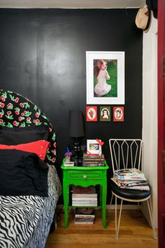 headboard, lime green night stand and pinups pop against black bedroom wall from the Houzz feature http://www.houzz.com/ideabooks/9618710/list?utm_source=Houzz_campaign=u286_medium=email_content=gallery9
