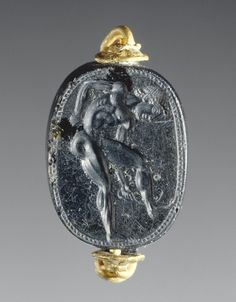 Gem with an Athlete Cleaning Himself with a Strigil (Getty Museum). Attributed to Epimenes Greek, Cyclades, about 500 B. Obsidian set in a modern gold ring x x in. Roman Jewelry, Greek Jewelry, Old Jewelry, Antique Jewelry, Historical Artifacts, Greek Artifacts, Getty Museum, Ancient Jewelry, Grey And Gold