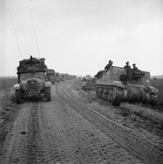 11th Armoured Division vehicles during the advance in The Netherlands, 22 September 1944. On the right is a Sexton self-propelled gun of 13th (HAC) Regiment Royal Horse Artillery.