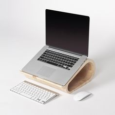 The Wooden Laptop Stand by Lesha Galkin, Via Behance.