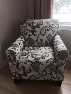 This chair is in our living room right now, with the grey couch. It has grey and blue and turquoise in it. I actually like the pattern in this chair.