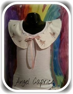 Facebook.com/angelcaprice1. Im loving the Peter Pan collar at the moment. X