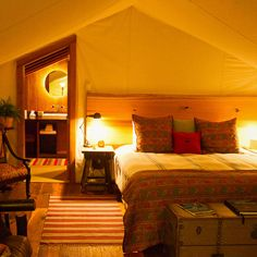 love the idea of canopying or tent-ing a room that comes to a point to make it look like a tent or fort