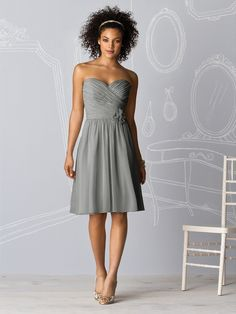 I think this may be the dress...  Gray Bridesmaid Dress @Charlotte Coulter