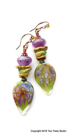 Iris Rocaille: These meltingly beautiful artisan earrings are all luscious blooming color and defined form in artisan glass.  By Two Trees Studio.