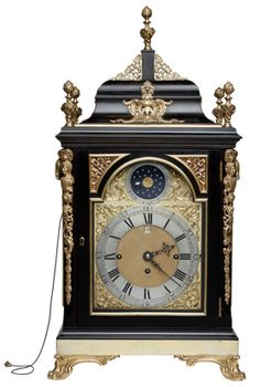 "John Ellicott | Bracket Antique Clock A fine mid 18th century ebony and gilt mounted three train quarter striking bracket clock of important size and proportions by this eminent maker who held the position ""clockmaker to the King"". The case with exceptionally fine gilt mounts and finials, the triple fusee movement striking the quarters on eight bells and repeating at will. The arched dial with rare rotating ball showing age and moon phases, fine spandrels and signature which is repeated to…"