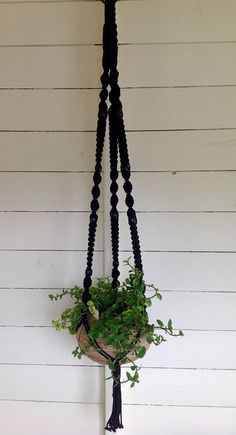 MAKRAME MAGIK EXTRA CHUNKY HANDCRAFTED MACRAME PLANT HANGER Handcrafted & designed in the UK by Kathryn. For this design I used 4mm nylon cord, this design is available in black. It can be used indoor or out, It is very robust & will not bio degrade. This could be displayed in a