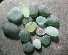 A selection of green teal and aqua sea glass from North by jazomir