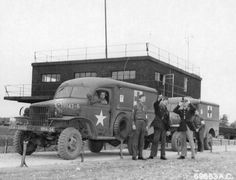 WC-27 ambulances of the 70th Service Group await the return of the 386th Bomb Group's B-26 Marauders, RAF Great Dunmow, Essex, England, United Kingdom, Oct 5, 1943. (US Army Air Forces)