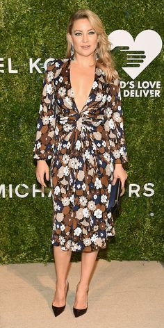 Look of the Day - Kate Hudson in  a plunging Michael Kors Collection dress with a sweet floral print at the God's Love We Deliver Golden Heart Awards. A set of black and white shoulder-duster statement earrings and black patent pumps rounded out her sultry ensemble.