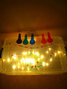 Homemade light box using Christmas lights and a clear plastic bin.  You can tape parchment paper on the underside of the cover to spread the light more evenly.