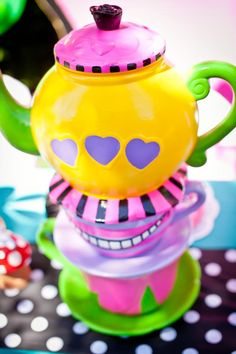 Mad Hatter Tea Party centerpiece by : WONDERLAND PARTY PROPS  ( 661 250-8164  )  See us on Facebook for prop rental and decorating services.