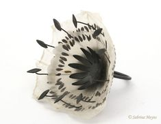 These delicate handmade paper and silver jewelry pieces are by Irish artist Sabrina Meyns . To see more of her work go to her website . Paper Jewelry, Textile Jewelry, Jewelry Art, Silver Jewelry, Jewelry Design, Flower Jewelry, Silver Ring, Contemporary Jewellery, Modern Jewelry