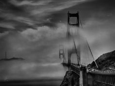 Low clouds form a layer of mist engulfing the Golden Gate Bridge in San Francisco, CA.