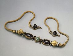 Necklace. Date: Third quarter of 2nd century bc. Place of finding: Artiukhovsky Barrow, Grave No. 1. Archaeological site: Kuban. Material: gold, garnets, emeralds and sardonyx