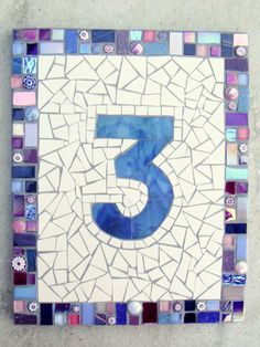 Handmade mosaic house number on a weatherproof Corian base using frost and UV safe materials; stained glass number, and coordinating glass border in a mix of blues, purples and a splash of pink. Mirror Mosaic, Mosaic Art, Mosaic Glass, Glass Ceramic, Fused Glass, House Number Plaque, House Numbers, Mosaic Designs, Mosaic Ideas