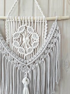 This elegant panel of natural cotton cord will decorate the walls of your room and create a feeling of warmth and comfort. Soft colors - beige and milk will suit any style of interior. Macrame Wall Hanging Diy, Macrame Curtain, Macrame Art, Macrame Design, Macrame Projects, Macrame Knots, Modern Macrame, Micro Macramé, Diy Keychain