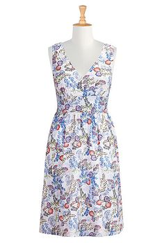 Floral drawings pattern our light cotton dress styled with a surplice V-neck and banded empire waist for an universally  flattering shape.