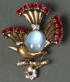 VINTAGE CROWN TRIFARI MOONSTONE & RHINESTONE BIRD PIN Faux moonstone belly, gold-washed sterling with red un-foiled rhinestones and bright clear rhinestone highlights. Circa 1942.