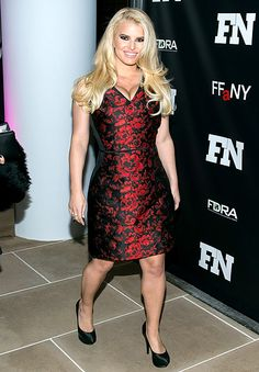 Jessica Simpson shows off her major cleavage and slim body in a red Carolina Herrera dress on the red carpet.