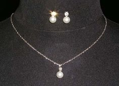 """Rhinestone Jewelry Corporation 15013 - Classic Pearl Dot Necklace Set  $1.25 per set. This necklace is 15.25"""" - 18.25"""" long (adjustable.) The earrings are 1/2"""" tall. Plated in Sterling Silver. Carded and in a plastic bag. Minimum order for this style: 12"""