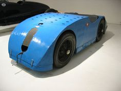 "Bugatti Type 32, commonly called the Tank de Tours, was a streamlined racing car built in 1923. Four examples were made, each with a 2.0 L (1991 cc/121 in³) straight-8 engine based on that in the Type 30. ""The Tank"" finished third in the ACF Grand Prix that year."