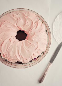 Dark chocolate chiffon cake with rosewater frosting.