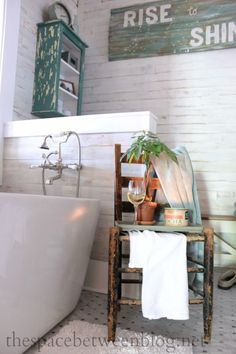 Great master bathroom renovation. She shares many DIY projects and tips and tricks on everything from tiling and building a vanity to installing rolling door hardware