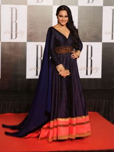 Sonakshi Sinha: Looks like our Bollywood beauties just cannot do without Manish Malhotra. The Dabangg girl wears a beautiful dark blue and orange floor sweeping outfit.