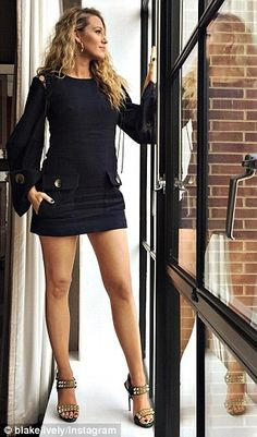 The pregnant beauty also shared two meaningful snaps on her Instagram in which her stunning legs were on full display as she posed on the sill of a large window looking out over the city. She captured the first one, where she's striking a serene pose, 'Expectation,' then gasps as she looks down in a snap titled, 'Reality'