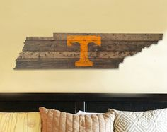 (Size shown in picture: 12 x 48)   Custom built and painted wood Tennessee flag cut out with the state flag seal painted and distressed on it.