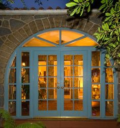 A view to the open interior is through French doors set in a stone arch.===Perfect for carriage house with arch !!