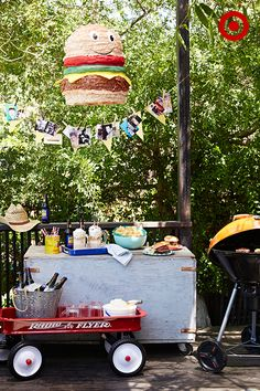 What's better than burgers at a Father's Day party? A burger piñata and a root beer float bar, of course! Roll up to the grill with a wagon filled with root beer, vanilla ice cream and mugs, and personalize the party with a garland detailed with family photos and memories.