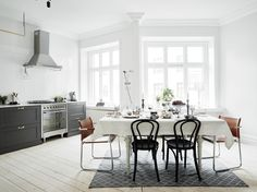 Classy & Clean Home in Gothenburg, Sweden - thonet chairs, edison bulbs, wire cage lamps