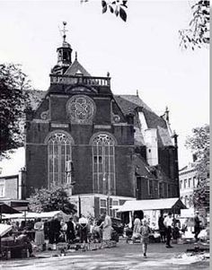 1950's. Market at the Noordermarkt. The Noordermarkt is a square in the Jordaan neighborhood of Amsterdam. The square is surrounded by cafés and restaurants. Markets are held on the square every Monday. In the 1950's and 1960's the square also hosted a pigeon market on Saturdays. Noordermarkt dates back to 1616. After completion in 1623 of the Noorderkerk church the square came to be known as Noordermarkt. #amsterdam #1950 #Noordermarkt #Noorderkerk