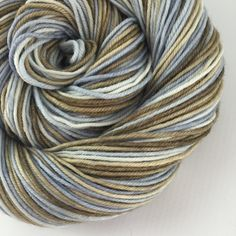 LITTLE BOY BLUE ~ hand-dyed yarn. Colors: shades of pale blue and brown (I use only professional grade dyes)  Yards: +\- 232  Weight: DK, 4- ply  Fiber: 100% superwash merino  Care instructions: This can be machine washed. To make finished items keep their vibrant colors, hand wash. Lay flat and shape to dry. #yarnbaby