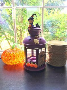 If you love Halloween this lantern is perfect for you! All the pieces decorating the lantern are made from polymer clay. There are glow in the dark pumpkins all the way around the outside of the lantern. There are spooky glow in the dark ghosts popping up from the tombstone. There is an adorable black cat sitting on top, it looks like he just finished snacking on some fish. Lastly there is a witch atop the lantern. She holds a glow in the dark pumpkin, and this lantern is her home.  This…