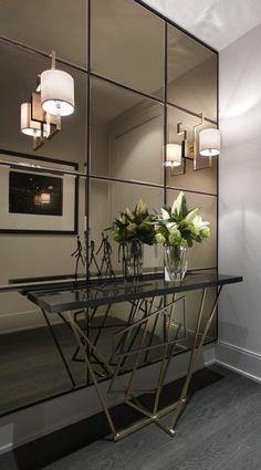 meubles art deco, grand miroir mural avec appliques murales, console noire