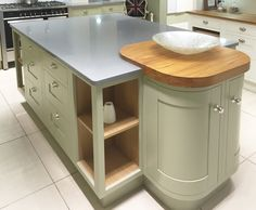 Traditional kitchen island design with curved units, open shelving and butchers block worktop. www.erkitchens.co.uk
