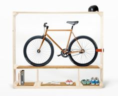 Wooden bookcase with integrated bike stand designed by Thomas Walde