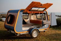 carapate adventure unveiled a yacht-inspired camper which rethinks the teardrop trailer with its trapezoid shape. The post boat-like trailer opens up to the world with oversized side entry appeared first on designboom Best Travel Trailers, Camper Trailers, Camper Van, Off Road Camper Trailer, Bike Trailer, Adventure Campers, Motorhome, Lightweight Campers, Campers For Sale