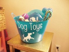 I made this dog toy bin using a plastic bin from the dollar store & made a custom decal that I designed & cut out on white contact paper using my cricut explore
